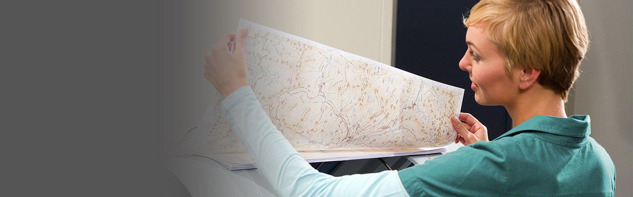 image of a woman reviewing GIS printed materials