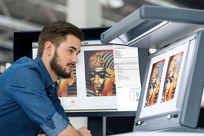 Image of TrueProof Prepress Proofing Software being used by a young man